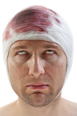 concussion: Bandage on human brain concussion blood wound head Stock Photo