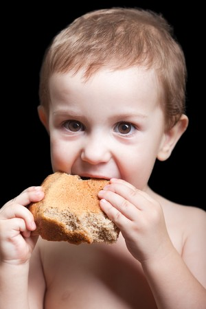 Poverty people little child boy eating bread food photo