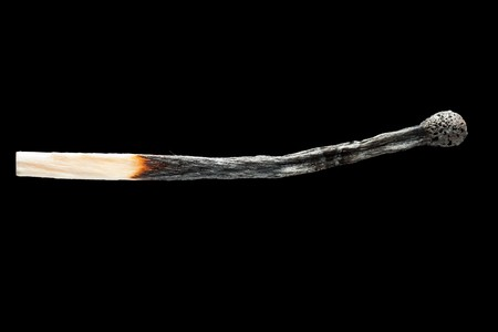 Fire flame heat burnt wooden match black isolated photo