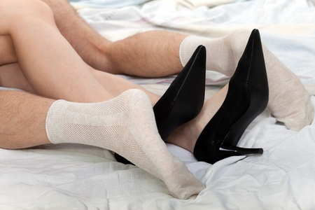 young couple sex: Human sex - men and women couple foot on bed