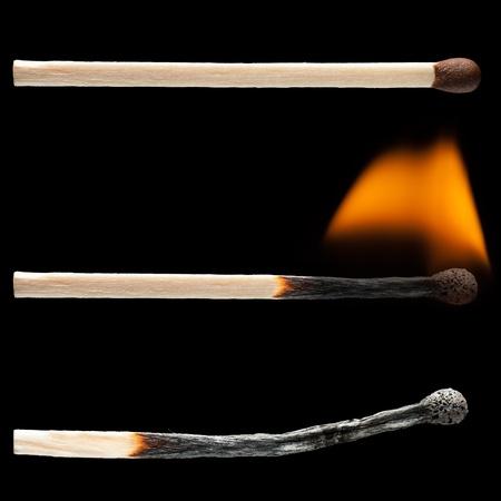 lucifers: Brand hitte van de vlam brand hout wed strijd black geïsoleerd Stockfoto