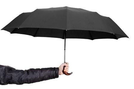 Women hand holding rain wet weather black umbrella photo
