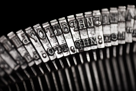 Old text typing typewriter letter typebar isolated photo