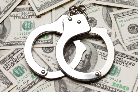 Crime law handcuffs arrests paper dollars currency photo