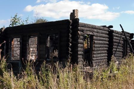 Fire heat burnt black coal ruined wood log house photo