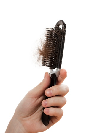 peine: Mano de mujeres de calvicie problema para la peine de p�rdida de pelo Foto de archivo