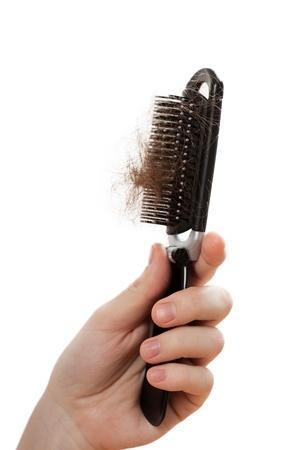 peigne: Probl�me de calvitie femmes main tenant la perte de cheveux peigne
