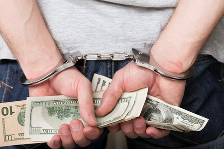 arrests: Handcuffs arrests dollar currency crime human hand