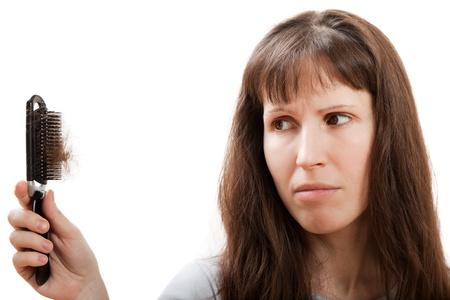 hair tuft: Balding problem women hand holding loss hair comb