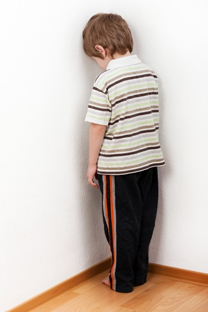 Little child boy wall corner punishment standing Stock Photo - 8755988