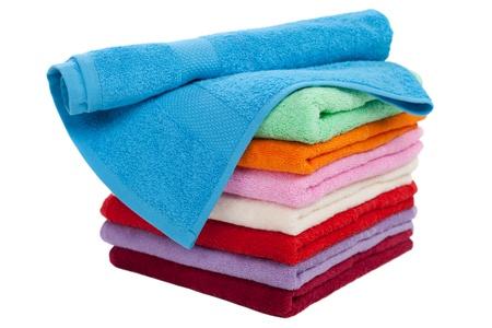 strandlaken: Clean cotton textile handdoek gevouwen stack geïsoleerd