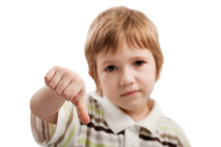 Human child hand gesturing thumb down failure sign photo