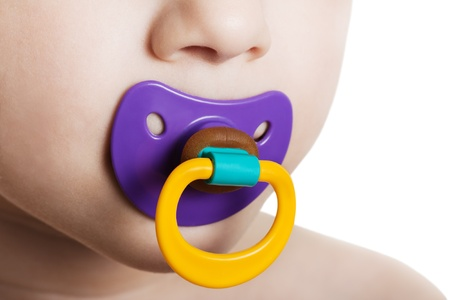soother: Little child boy and plastic baby soother pacifier