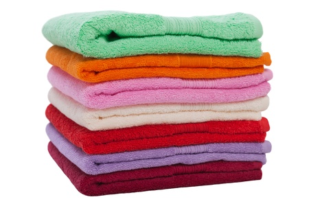 Clean cotton textile towel folded stack isolated photo