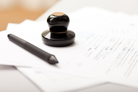 signing document: Seal stamp and pen writing business paper document Stock Photo