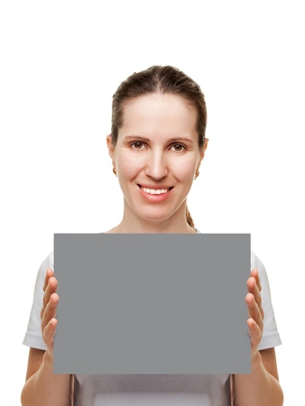 Smiling women hand holding grey empty blank card photo