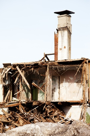 Hurricane earthquake disaster damage ruined house photo