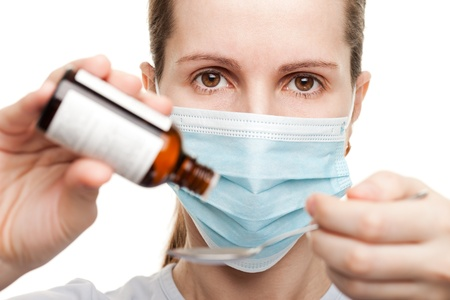 Mask doctor hand holding medicine healthcare syrup photo