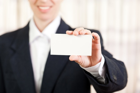 Smiling women hand holding white empty blank card photo
