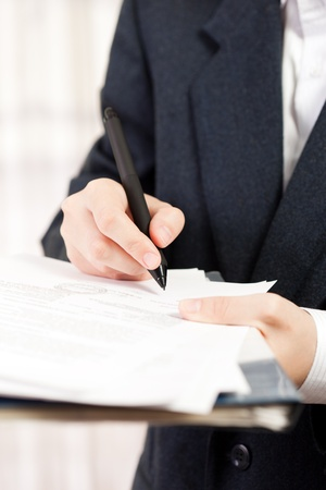sign contract: Human business men hand pen writing paper document Stock Photo
