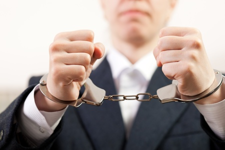 Police law steel handcuffs arrest crime human hand Stock Photo - 9583243