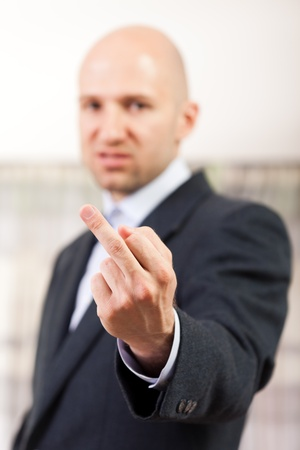 Human men hand gesture middle finger obscene sign photo