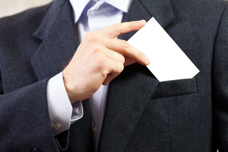 Business men hand holding white empty blank card Stock Photo - 9583255