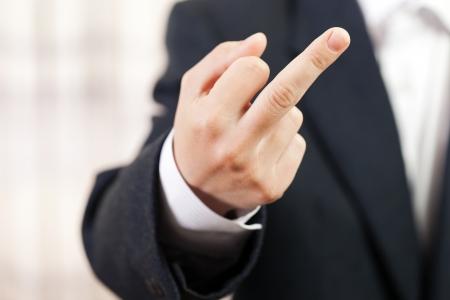 Business men hand gesture middle finger obscene sign photo