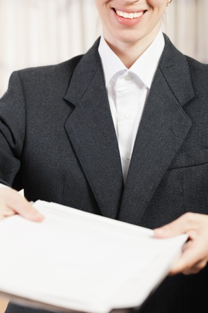 Paperwork - human hand holding business paper file photo