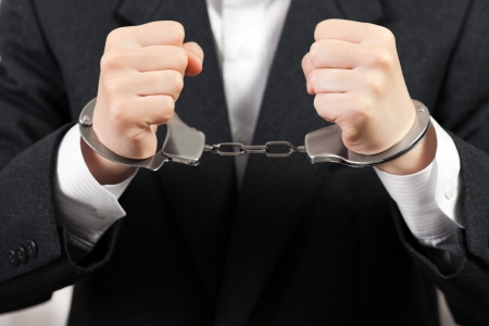 criminal law: Police steel handcuffs arrests business men hands