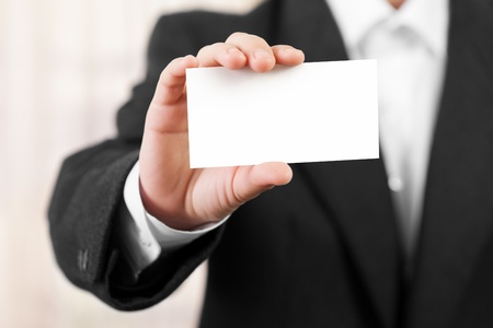 note card: Business men hand holding white empty blank card