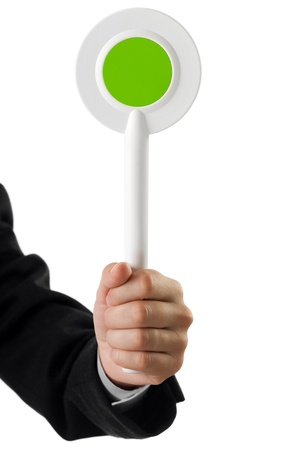 Human hand holding auction paddle voting card sign Stock Photo - 9789077