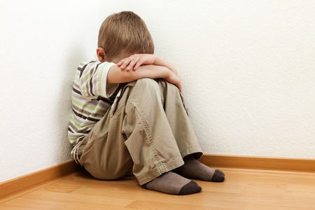 Little child boy wall corner punishment standing Stock Photo - 9790305
