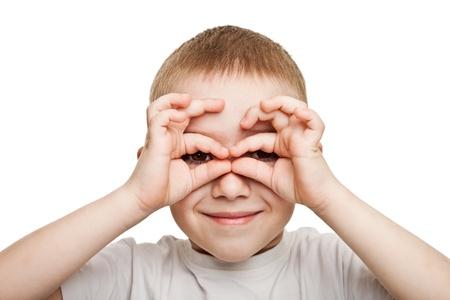 Smiling child boy hand hiding eyes for fun peeking Stock Photo - 9944702