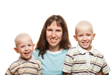 Smiling mother and little sons - family happiness photo