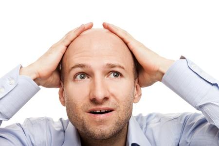 calvicie: Negocio sorprendido hombre mano calva cabeza rapada Foto de archivo