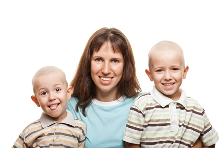 bald girl: Smiling mother and little sons - family happiness Stock Photo