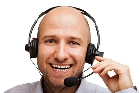 Smiling business man talking headphones or headset