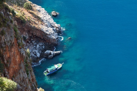 Summer vacations - water diving travel ship or boat at blue sea mountain beach bay photo