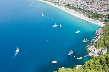 Summer vacations - blue Mediterranean sea and Cleopatra sand beach resort of Turkey Alanya view from ancient mountain castle wall photo