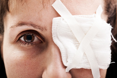 eye patch: Medicine plaster patch on human injury wound eye Stock Photo