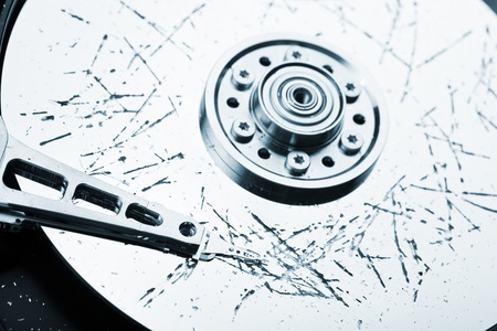 disaster recovery: Information storage data loss concept - broken computer technology hard disk drive surface Stock Photo