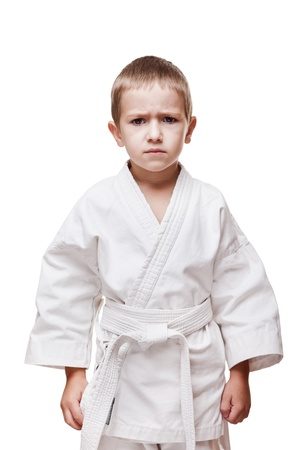 Martial art sport - child boy in white karate training kimono photo
