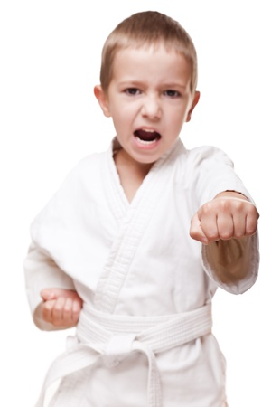 self defense: Martial art sport - child boy in white kimono training karate punch