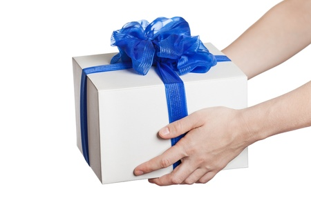 Human hand holding blue ribbon wrapped holiday surprise gift or present box package
