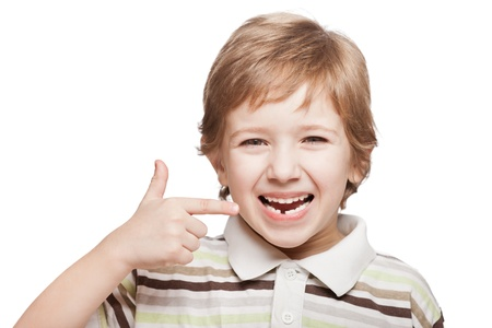 Little smiling child boy hand pointing his first baby milk or temporary tooth fall out photo