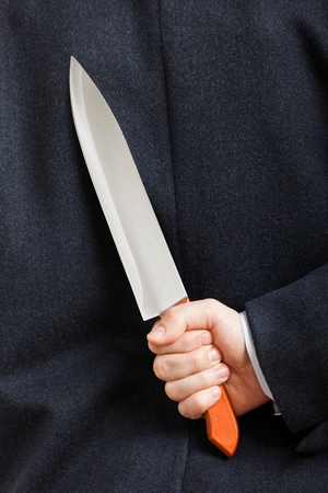 Murderer human hand holding sharp steel kitchen knife weapon photo