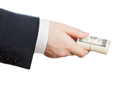Business man hand holding rolled up paper dollar currency photo