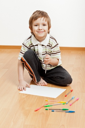 Little child drawing painting or writing letter photo
