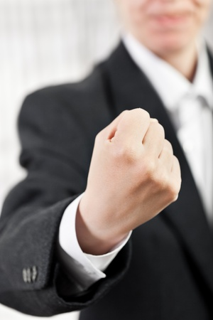 Anger screaming business man hand gesturing fist photo